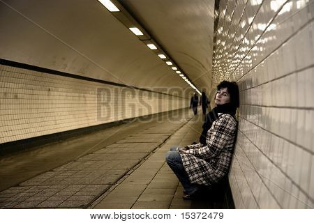 sad mature woman in a tunnel.