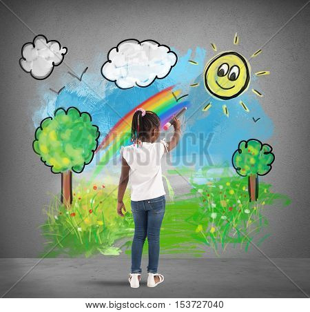 Creative little girl colors with a big pencil a green landscape