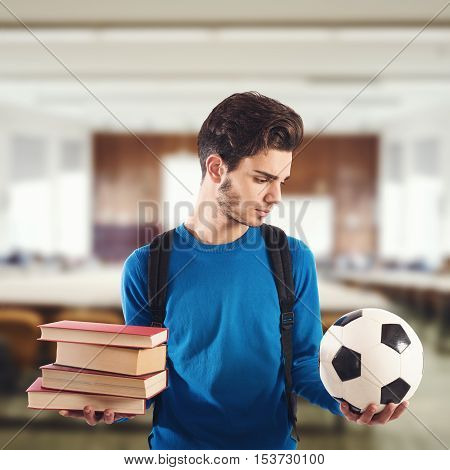 Boy chooses the ball instead of books at school