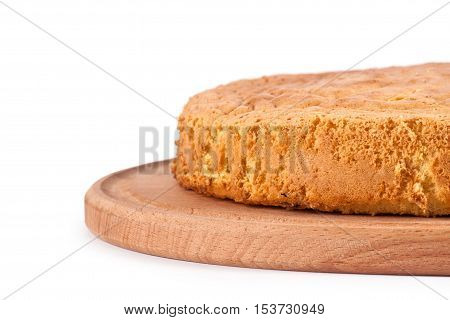 Sponge cake on wood board isolated on white background