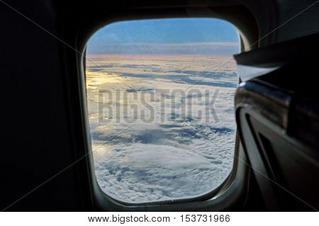 aerial view of blue sky with clouds from window of jet flight