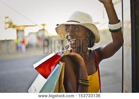 Joyful woman holding colorful shopping bags