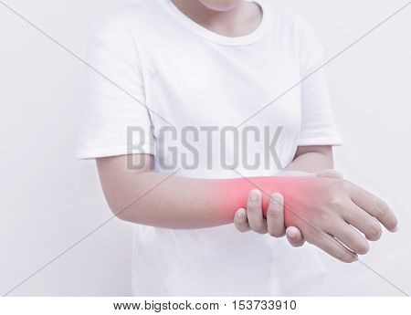 Young woman has pain in wrist, Health concept.