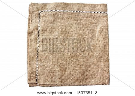 Beige fabric napkin ith embroidery isolated on white