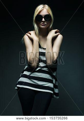 pretty fashion model on grey background