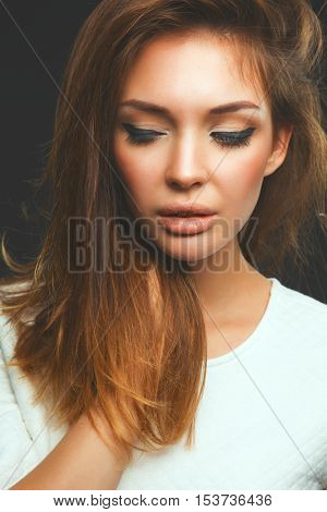 Portrait of a beautiful woman , isolated on black background .