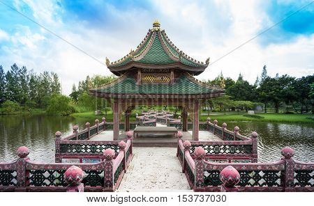 A Chinese designed of waterfront pavilion in the very big garden