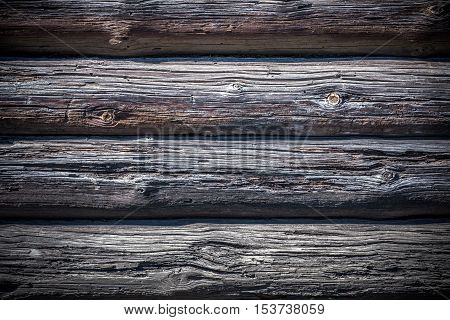 Wooden background of the parallel beams of pine