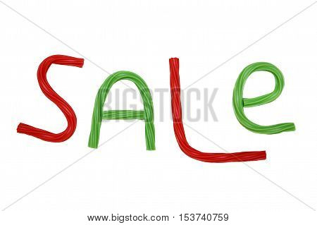 Christmas sale. inscription sale from the red and green twisted licorice candy.the concept of clearance sale in the traditional colors of  xmas. isolated on a white background
