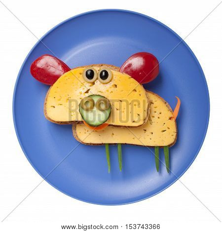 Pig made of bread and cheese on plate