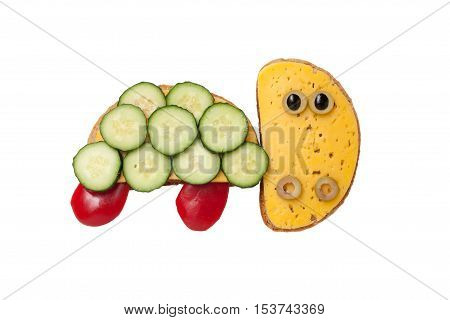 Turtle made of bread and vegetables on white background