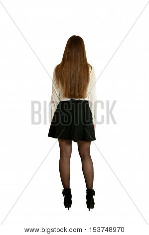 Woman in black skirt and heels standing full length, isolated on white background, back view