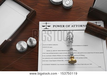 Pen, document, stamp and ink pads on notary public table