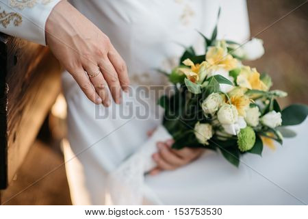 beautiful, fresh bridal bouquet in hands of the bride
