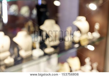 sale, consumerism, shopping and background concept - jewelry store showcase blurred bokeh