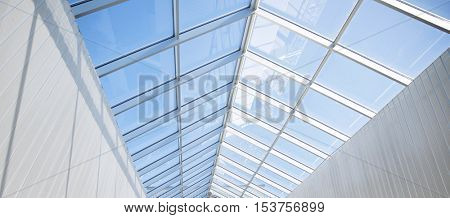 architecture and construction concept - modern building or pavilion glass roof