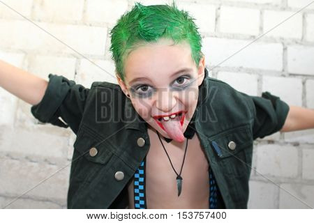 Shocking boy with green hair in the style of rock and roll.