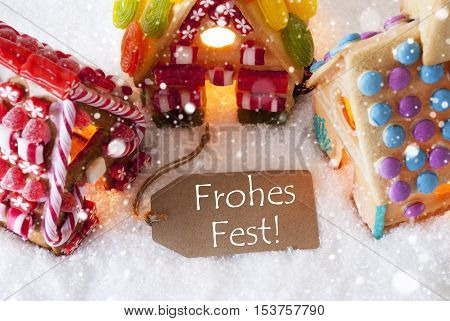 Label With German Text Frohes Fest Means Merry Christmas. Colorful Gingerbread House On Snow And Snowflakes. Christmas Card For Seasons Greetings