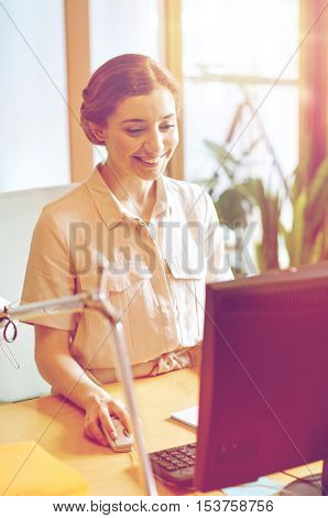 business, education, startup and people concept - happy woman or student with computer at office