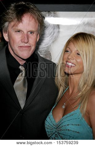 Gary Busey and Donna D'Errico at the Los Angeles premiere of 'The Queen' held at the Academy of Motion Picture Arts and Sciences in Beverly Hills, USA on October 3, 2006.