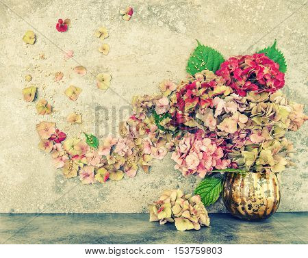 Hortensia flowers bouquet with golden decoration. Vintage style toned picture
