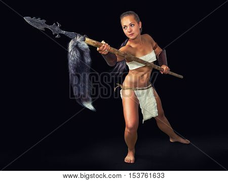 Beautiful girl in the image of ancient warrior with a spear.