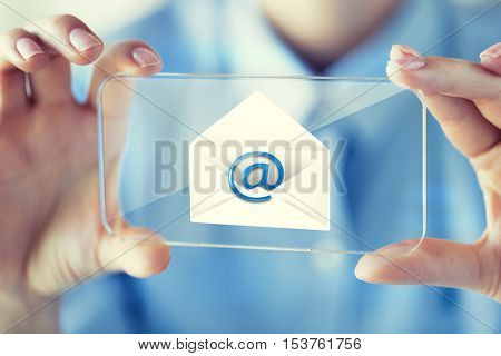 business, technology, communication and people concept - close up of woman hand holding and showing transparent smartphone with e-mail message on screen at office