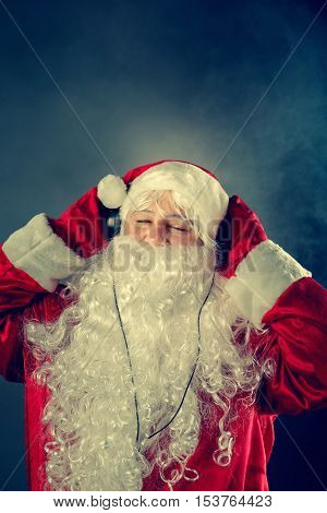 Authentic Santa Claus Is Listening To Music.