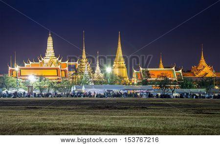 Bangkok Thailand - October 26 2016: Grand palace at night surround by black dress crowd to mourn the pass away King Bhumibol Adulyadej.