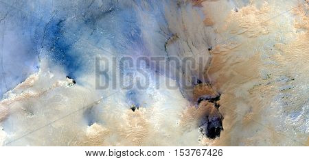 Abstract photography of landscapes of deserts of Africa from the air, allegory clouds