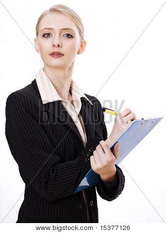 Attractive business researcher with a blue notepad