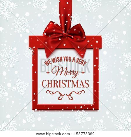We wish you a very merry Christmas, square banner in form of  gift with red ribbon and bow, on winter background with snow and snowflakes. Greeting card or banner template. Vector illustration.