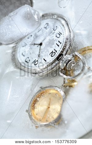 Few watches closeup under frozen water background