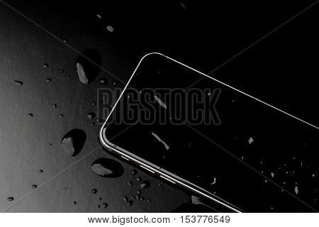 Waterproof smartphone with splashing of water on black  background