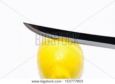 fresh lemon whith khife on white background