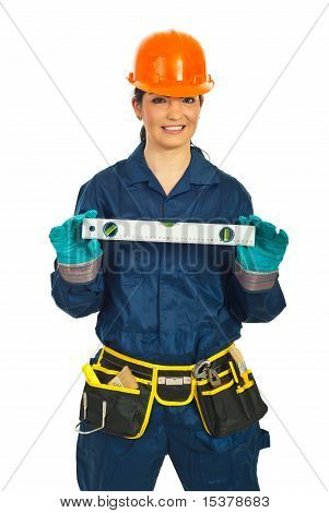 Happy Builder Woman Holding Bubble Level