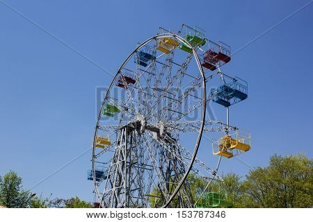 Multicolored Ferris Wheel with blue sky as background