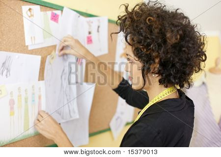 Woman With Sketches In Fashion Design Studio
