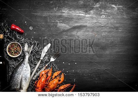 Fresh Fish And Shellfish On A Fishing Net.