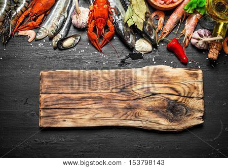 Cutting Board With A Variety Of Shrimp, Fish And Shellfish.