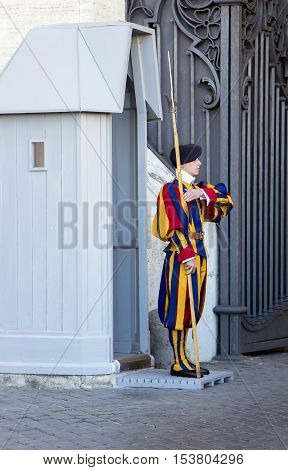 ITALY, VATICAN CITY, OCTOBER, 28, 2014 - Guard famous Pontifical Swiss Guard in Vatican, Italy.