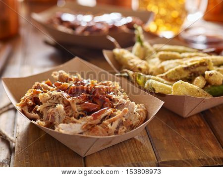 smoked pulled pork with barbecue sauce and fried okra