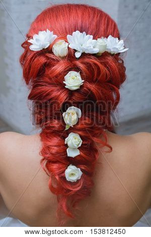 a long plait braided red-haired girl rose