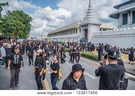 Bangkok Thailand - October 22 2016 : Thai people come for singing the anthem of His Majesty King Bhumibol at the road in front of the Royal Palace to pay respect for the king in Bangkok Thailand.