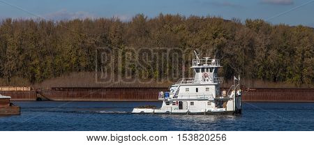 WABASHA MN/USA - OCTOBER 23 2016: Mississippi River tug boat and barge traffic panoramic view.