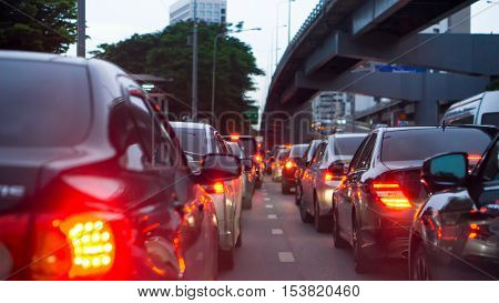 transportation vehicle and traffic concept - Blurred traffic jam and brake light in evening