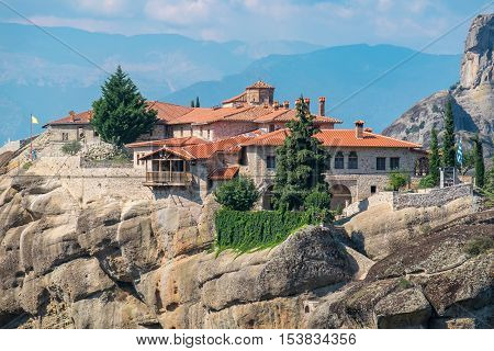 Rock formations of the Meteora with Monastery of Holy Trinity (Agia Triada). Meteora Plain of Thessaly Greece Europe