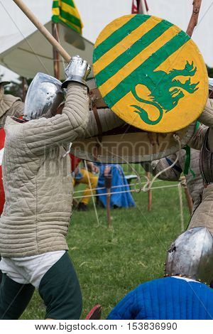 Knights in Battle with Silver Helmets and Shields: Medieval Event Reconstruction