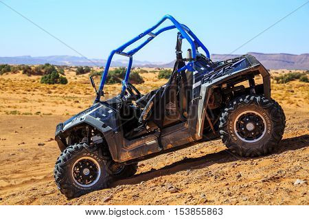 Merzouga Morocco - Feb 26 2016: blue Polaris RZR 800 with no pilot in Morocco desert near Merzouga. Merzouga is famous for its dunes the highest in Morocco.