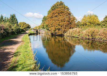 British autumn landscape. Lock on the canal